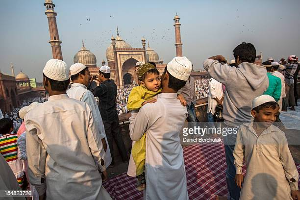 Indian Muslims celebrate after Eid alAdha prayers at Jama Masjid on October 27 2012 in New Delhi India Eid alAdha also known as the Feast of...