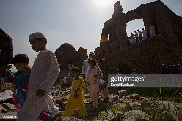 Indian Muslims depart from Eid ulFitr prayers at the Feroz Shah Kotla Mosque on September 21 2009 in New Delhi India Muslims all over the world are...