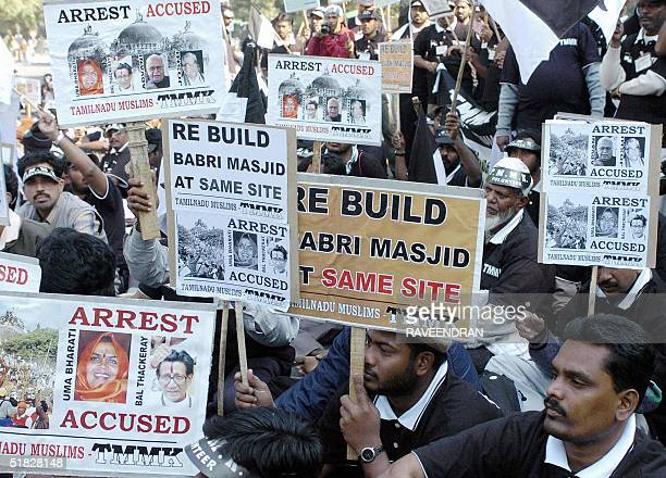 Indian Muslims from the southern state of Tamil Nadu hold placards bearing pictures of the leaders who are accused in the Babri Masjid Demolition...