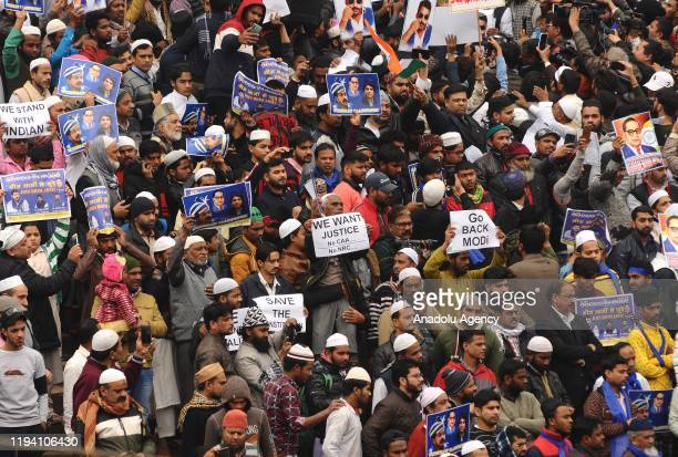 Indian Muslims gather for a protest against the Citizenship Amendment Act after Friday prayer outside the Jama Masjid mosque in New Delhi India on...