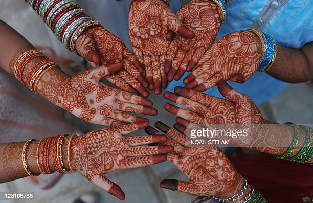 Indian Muslims girls holds out her decorated hands during Eid alFitr celebrations at the Qutub Shahi tomb in Hyderabad on August 31 2011 Muslims...