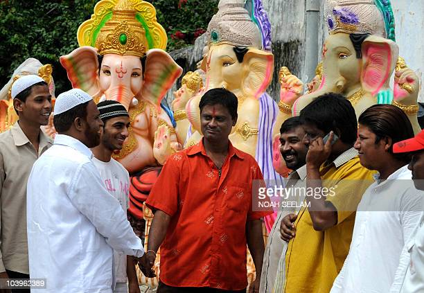 Indian Muslims greet Hindu vendors of Idols of Hindu Elephant God Lord Ganesh in The Dhoolpet District of Hyderabad on September 10 2010 The festival...