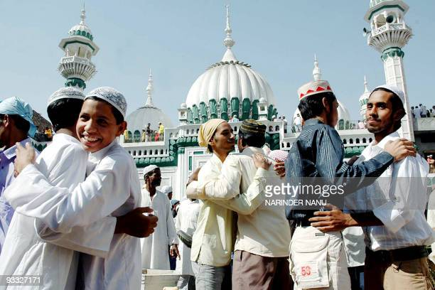 Indian Muslims greet one another following prayers at the 152yearold KhiruDin mosque in Amritsar 14 October 2007 on the occaision of EidalFitr The...