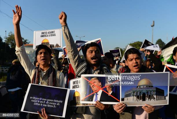 Indian Muslims hold placards during a protest rally in New Delhi on December 17 following US President Donald Trump's decision to officially...