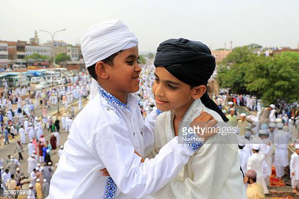 Indian Muslims hug each others after offer 'Namaz' prayer at Idgah Mosque on the occasion of EidalFitr festival in Jaipur India Saturday July 18...