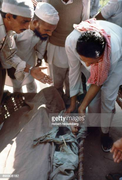 Indian Muslims identify and bury Muslim victims of Hindu attacks by Hindu fundamentalist mobs over the attempted destruction of Ayodhya's Babri...
