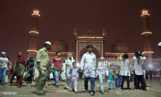 Indian Muslims leave after breaking their fast during the fasting month of Ramadan at the Jama Masjid Mosque in New Delhi on July 24 2012 Like...