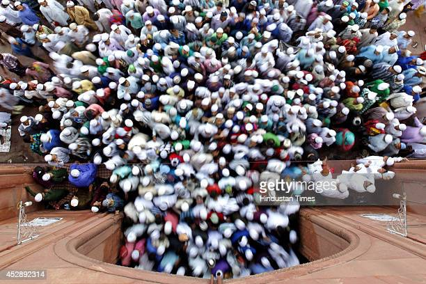 Indian Muslims leave after offering prayers on the occasion of Eidulfitr at Jama Masjid on July 29 2014 in New Delhi India The festival of Eid was...