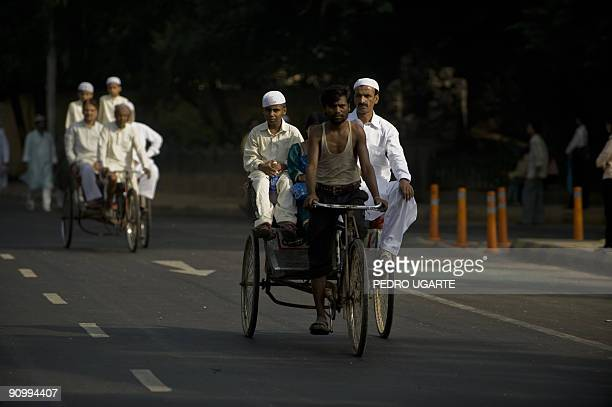Indian Muslims leave the Jama Masjid mosque after offering the early morning Eid alFitr prayer in New Delhi on September 21 2009 Muslims around the...