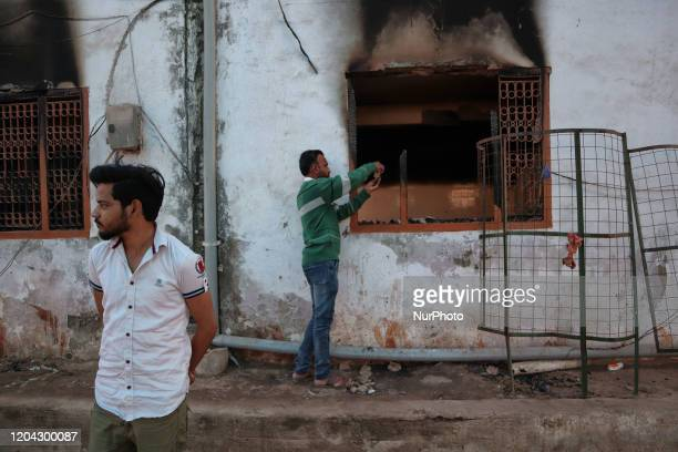 Indian muslims look inside a charred mosque after it was set on fire by a mob during riots in Mustafabad area of New Delhi India on 29 February 2020...