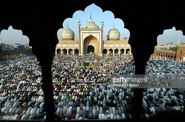 Indian muslims offer Eid alAdha prayers at the Jama Masjid in New Delhi 02 February 2004 Muslims all over the country celebrates the second biggest...