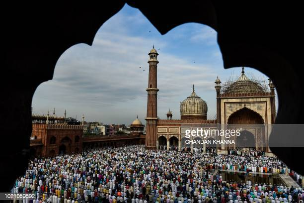 TOPSHOT Indian Muslims offer Eid alAdha prayers at the Jama Masjid mosque in New Delhi on August 22 2018 Muslims are celebrating Eid alAdha the...