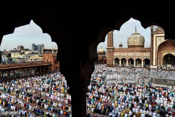 Indian Muslims offer Eid alAdha prayers at the Jama Masjid mosque in New Delhi on August 22 2018 Muslims are celebrating Eid alAdha the second of two...