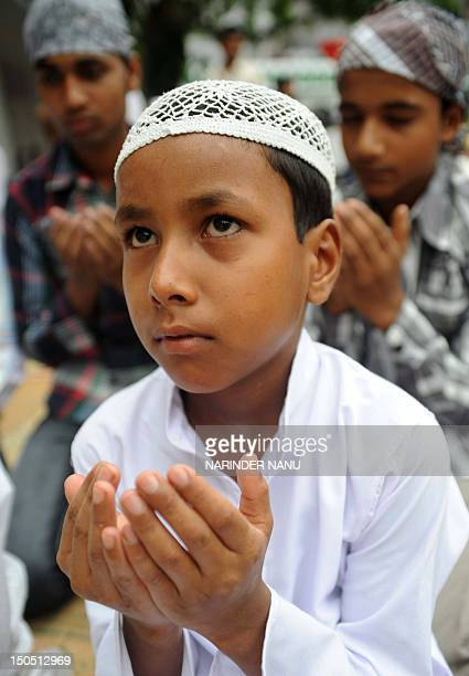 Indian Muslims offer Eid alFitr prayers at The Kharudin Mosque in Amritsar on August 202012 Millions of Muslims across Asia began celebrating the Eid...