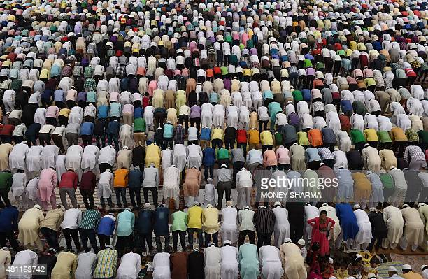 Indian Muslims offer prayers during Eid alFitr at Jama Masjid mosque in New Delhi on July 18 2015 Muslims around the world are celebrating the Eid...