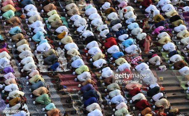 Indian Muslims offer prayers during Eid alFitr at the Jama Masjid mosque in New Delhi on June 26 2017 Muslims around the world are celebrating the...