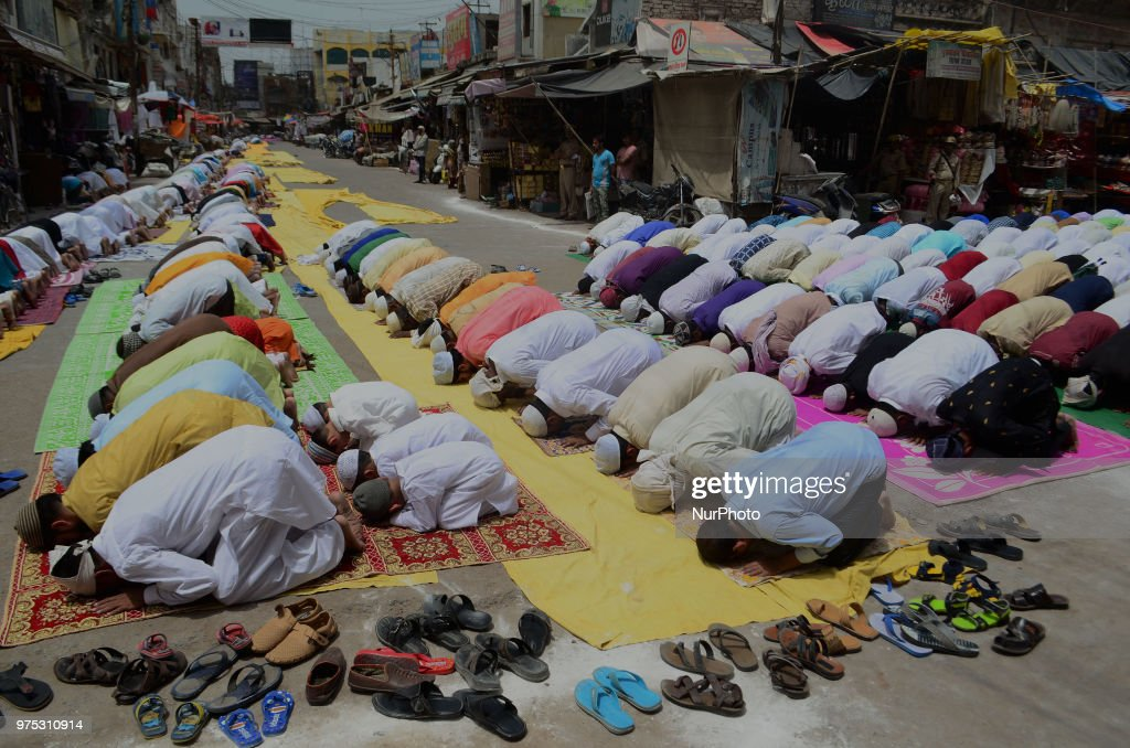 Indian muslims offer prayers on the last congregational friday of the holy month of Ramadan, following the Muslim Festival Eid al-Fitr ,the biggest muslim festive event, in the old streets of Allahabad on June 15, 2018.