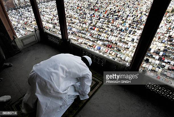 Indian Muslims offer prayers on the occasion of the Eidal Fitr festival at the Jama Masjid mosque in New Delhi 04 November 2005 Muslims all over the...