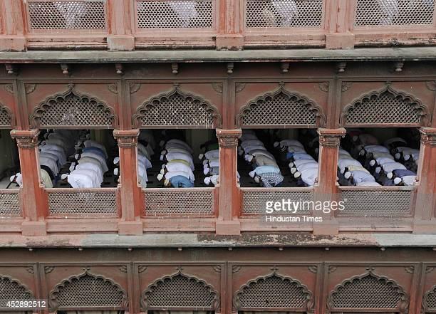Indian Muslims offering prayers on the occasion of Eidulfitr at Nakhoda Masjid on Zakaria Street on July 29 2014 in Kolkata India The festival of Eid...