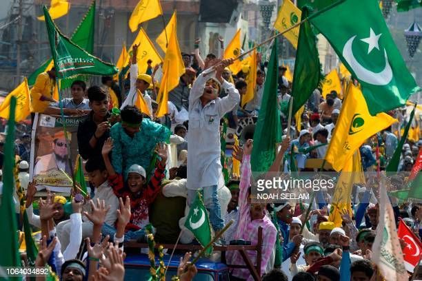 Indian Muslims participate in a procession during Eid MiladunNabi which marks the birth anniversary of Prophet Muhammad in Hyderabad on November 21...