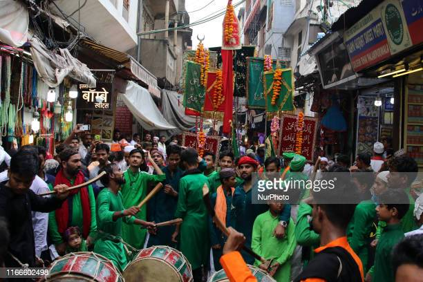 Indian Muslims participate in a procession during the sacred Islamic month of Muharram outside the shrine of Sufi saint Khwaja Moinuddin Chishti in...
