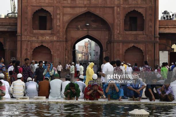 Indian Muslims perform ablutions before breaking their fast during the holy month of Ramadan at the Jama Masjid in the old quarters of New Delhi on...