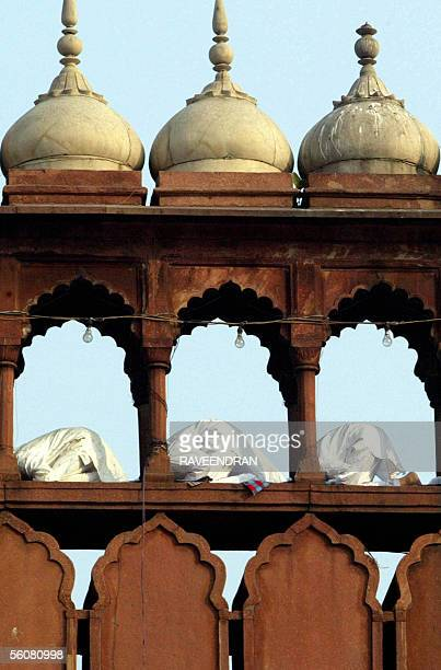 Indian Muslims pray in a covered alley on top of the Jama Masjid mosque as they celebrate the Eidal Fitr festival 04 November 2005 in New Delhi...