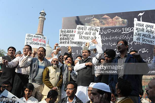 Indian Muslims shout slogans during a protest to mark the demolition of the 16th century Babri Mosque in Ayodhya on the 20th anniversary in front of...
