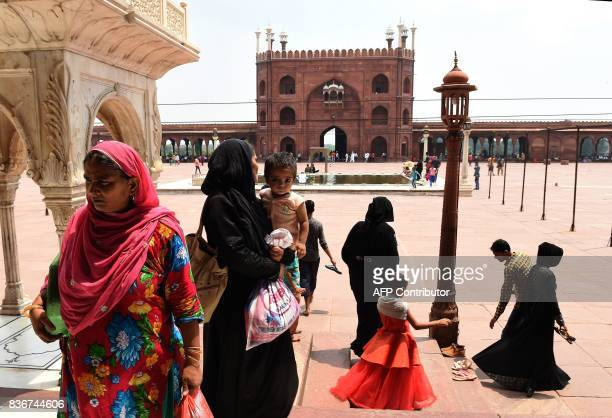 Indian Muslims visit the Jama Masjid mosque in New Delhi on August 22 2017 India's top court on August 22 banned a controversial Islamic practice...