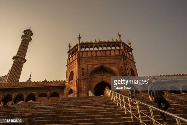 Indian Muslims walk on the stairs of the mosque after offering congregational prayers at the Jama Masjid , as the country relaxed its lockdown...