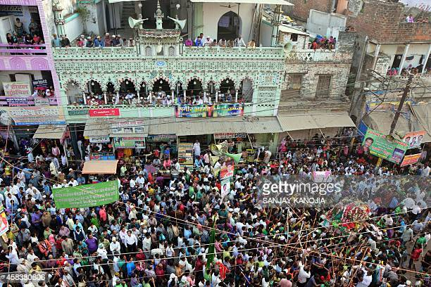 Indian Muslims watch a Muharram procession marking Ashura in Allahabad on November 4 2014 During the Shiite Muslim holy month of Muharram large...