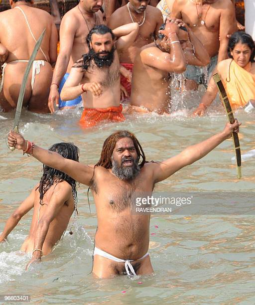 Indian Naga Sadhus Holy Men bathe at HarkiPauri in the River Ganges in Haridwar on February 12 during the First Shahi Snan Royal Bath on Maha...