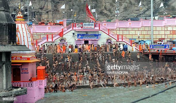 Indian Naga Sadhus Holy Men bathe at HarkiPauri in the River Ganges in Haridwar on February 12 during the First Shahi Snan Royal Bath on Maha...