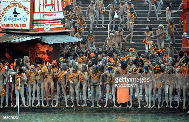 Indian Naga Sadhus Holy Men prepare to bathe during the First Shahi Snan Royal Bath on Maha Shivratri during the Kumbh Mela in Haridwar on February...