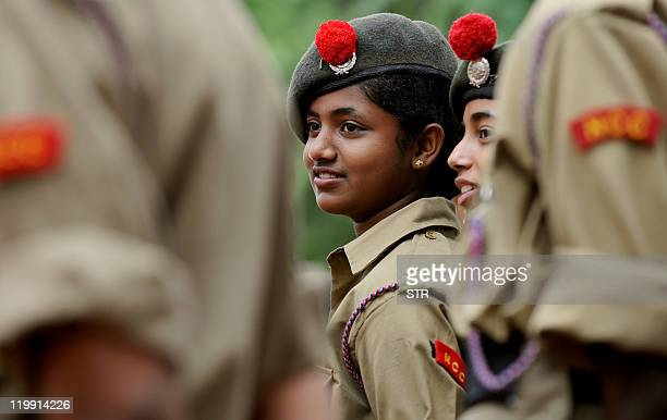 Indian National Cadet Corps members interact as they take part in 'Flags of Honour' an event held at The National Military Memorial Park in Bangalore...