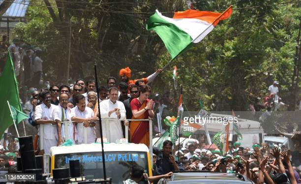 Indian National Congress Party president Rahul Gandhi and Priyanka Gandhi Vadra gesture to supporters on Rahul's visit to file his candidacy...
