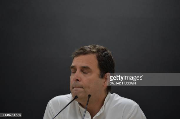 Indian National Congress Party president Rahul Gandhi gestures as he speaks during a press conference at the party headquarters in New Delhi on May...
