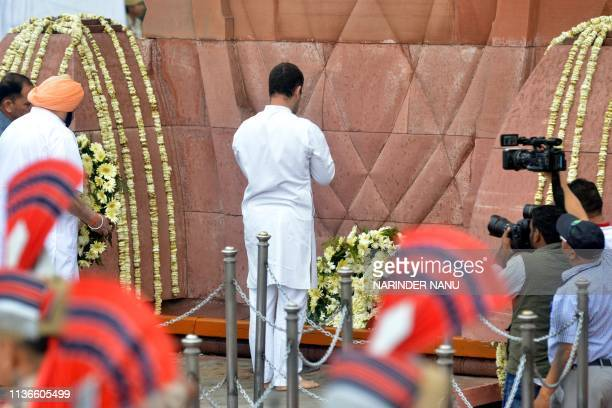Indian National Congress party president Rahul Gandhi pays tribute after laying a wreath on the 100th anniversary of the Jallianwala Bagh massacre at...