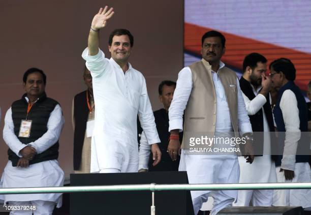 Indian National Congress party President Rahul Gandhi waves during a political rally held at Gandhi Maidan in Patna in the Eastern state of Bihar on...