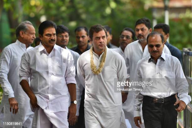 Indian National Congress President Rahul Gandhi arrives to meet party leaders and supporters on his 49th birthday, at party headquarters, on June 19,...
