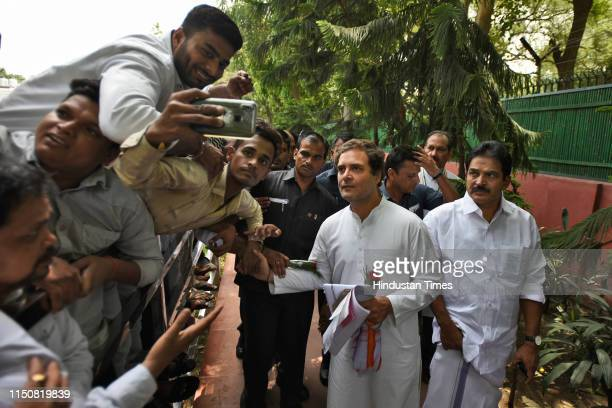 Indian National Congress President Rahul Gandhi is greeted and welcomed by his party supporters on his 49th birthday, at party headquarters, on June...