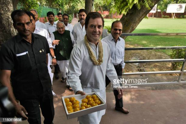 Indian National Congress President Rahul Gandhi offers sweets to media persons on his 49th birthday, at party headquarters, on June 19, 2019 in New...