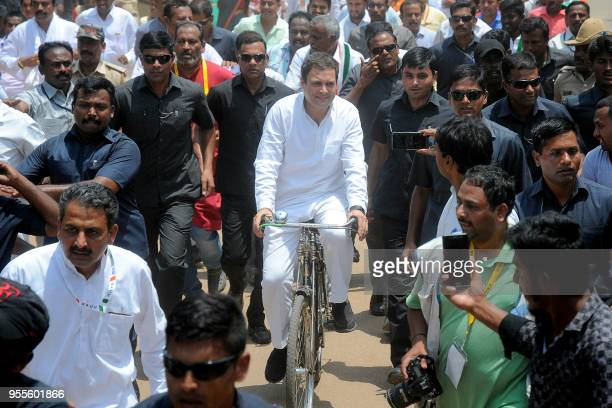 Indian National Congress president Rahul Gandhi rides a bicycle during an election camapaign for the forthcoming Karnataka Legislative Assembly...