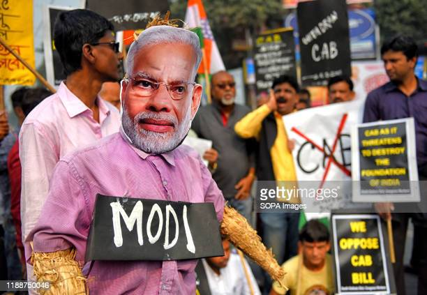 Indian National Congress Supporter holds an effigy of the Indian Prime Minister Mr. Narendra Modi for sanctioning the CAB bill during the...