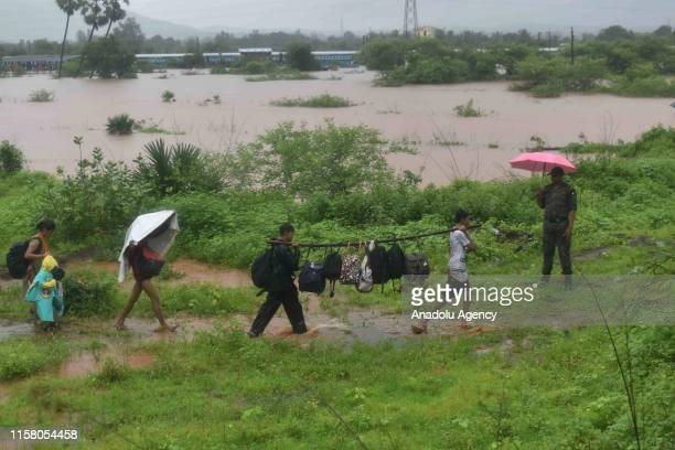 Indian National Disaster Response Force work to rescue passengers of a stranded train in Badlapur India Saturday July 27 2019 Rescuers in India on...