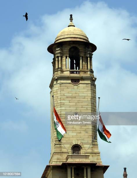 Indian national flag flies at halfmast at the Parliament house following the death of former prime minister Atal Bihari Vajpayee at Janpath on August...
