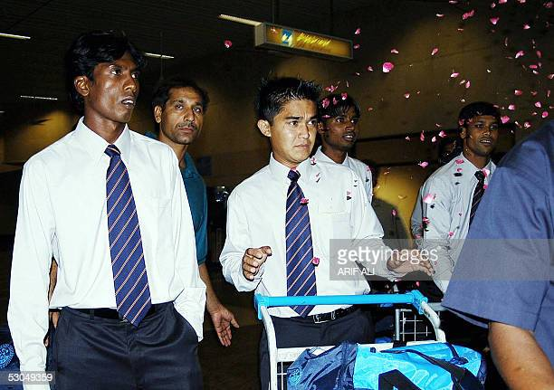Indian national football team members are greeted with a shower of rose petals upon their arrival at the Allama Iqbal International Airport in Lahore...