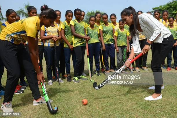 Indian national hockey captain Rani Rampal plays field hockey during her visit to the Khalsa Hockey Academy in Amritsar on September 15 2018