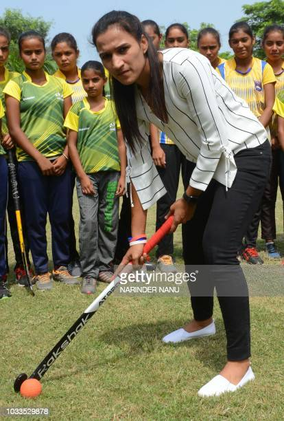 Indian national hockey captain Rani Rampal poses as she plays field hockey during her visit to the Khalsa Hockey Academy in Amritsar on September 15...