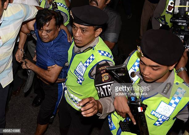 Indian national Rajendra Sadashiv Nikalje known in India as Chhota Rajan is held by Indonesian police prior to being escorted from Bali police...